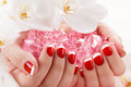 Beautiful manicure nail salon woman in receiving by beautician Stock Photo
