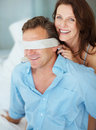 Beautiful mature woman blindfolding husband Royalty Free Stock Photo