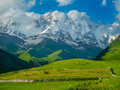Beautiful meadow landscape near ushguli svaneti georgia shkhara mountain in the background Royalty Free Stock Photo