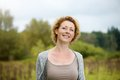 Beautiful middle aged woman smiling outdoors close up portrait of a Stock Photo