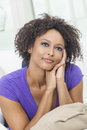 Beautiful mixed race african american girl young woman looking happy thoughtful Stock Photos