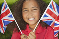 Beautiful Mixed Race Girl with Union Jack Flags Stock Photography
