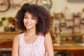 Beautiful mixed race woman smiling in a coffee shop Royalty Free Stock Photo