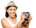 Beautiful mixed race woman taking photograph vintage camera isol holding Stock Images