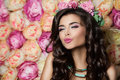 Beautiful Model Blowing a Kiss on Summer Flowers Backgr Royalty Free Stock Photo