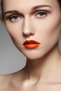 Beautiful model with bright red lips make-up, pure skin Stock Photography