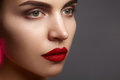 Beautiful model with fashion make-up. Close-up portrait sexy woman with glamour lip gloss makeup and bright eye shadows. Royalty Free Stock Photo