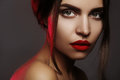 Beautiful model with fashion make-up. Portrait woman with glamour red lips makeup, strong eyeshadows, hairstyle Royalty Free Stock Photo