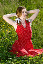 Beautiful model in field of flowers Royalty Free Stock Photography