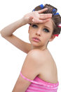 Beautiful model with hair curlers posing poing on white background Royalty Free Stock Photo