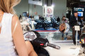 Beautiful model on a motorbike at eicma in milan italy november poses international motorcycle exhibition november Stock Image