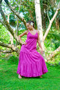 Beautiful model posing against exotic trees Royalty Free Stock Images