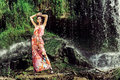 Beautiful model posing in front of a waterfall fashion Stock Image