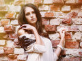 Beautiful model standing near old brick wall Royalty Free Stock Photo