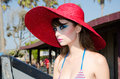 Beautiful model stunning young lady with red hat posing in newport beach california Royalty Free Stock Image