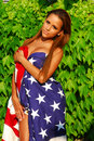 Beautiful model wrapped in Old Glory Stock Photography