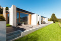 Beautiful modern house in cement view from the garden Royalty Free Stock Images