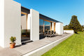Beautiful modern house in cement view from the garden Royalty Free Stock Photo