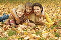 Beautiful mom and her children are in the autumn park Stock Photo