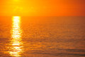 Beautiful morning sunrise on the ocean in light orange Stock Photos