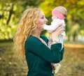Beautiful mother and baby happy outdoor Stock Photography