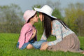 Beautiful mother and beloved daughter mom have fun relaxing in the park Royalty Free Stock Photography