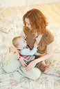 Beautiful mother breast feeding her infant Royalty Free Stock Images