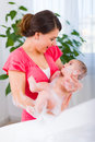 Beautiful mother cleaning baby Royalty Free Stock Photo
