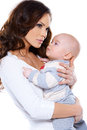 Beautiful mother cradling her little baby Royalty Free Stock Photography