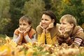 Beautiful mother and her children are in the autumn park Stock Photo