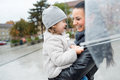Beautiful mother holding her little daughter under the umbrella. Royalty Free Stock Photo