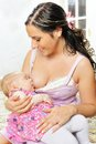 Beautiful mother nursing her  newborn baby Stock Photos