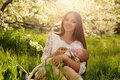 Beautiful mother posing with her little cute baby in blossom garden Royalty Free Stock Photo