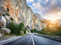 Beautiful mountain asphalt road with rocks, blue sky at sunset Royalty Free Stock Photo