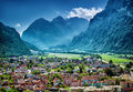 Beautiful mountainous village many little buildings in european mountain city luxury resort active travel and vacation concept Royalty Free Stock Photo