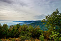 Beautiful mountains landscape from the top of the hill with fog Royalty Free Stock Photo