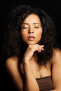 Beautiful mulatto woman with tiger make up over black background Royalty Free Stock Photography