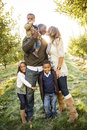 Beautiful multi ethnic family portrait a outdoors parents kissing while hugs each other Royalty Free Stock Images
