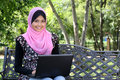 Beautiful muslim woman using laptop Royalty Free Stock Photo