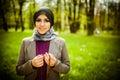 Beautiful muslim woman wearing hijab praying on rosary tespih and holding a holy book koran Royalty Free Stock Image