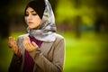Beautiful muslim woman wearing hijab praying on rosary tespih and holding a holy book koran Royalty Free Stock Photo