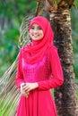 Beautiful muslimah lady wear blouse and hijab posing at garden Stock Image