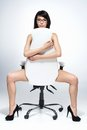 Beautiful naked dark-haired woman sitting on white chair. Royalty Free Stock Photo