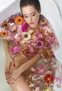 Beautiful naked female in bath with flowersl body Stock Photo