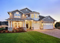 Beautiful new home exterior a clear evening provides a setting for this luxurious Royalty Free Stock Photography