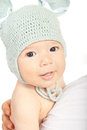 Beautiful newborn baby with wool cap newbornn knitted on mother shoulder isolated on white background Royalty Free Stock Photography