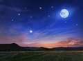 Beautiful night sky with the full moon and stars Royalty Free Stock Photo