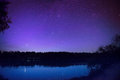 Beautiful night sky with many stars on a lake Royalty Free Stock Photo
