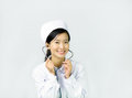 Beautiful nurse on a white isolated background female with stethoscope smile Stock Photography