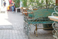 Beautiful old bench in street cafe Royalty Free Stock Photo